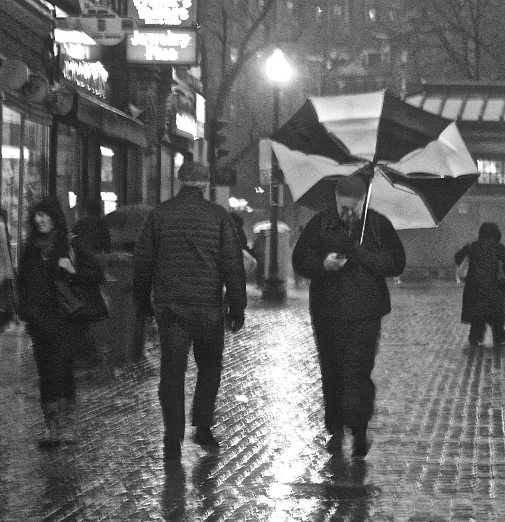 boston downtown crossing man with umbrella flapping up