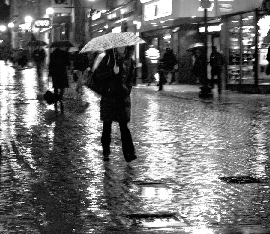 boston downtown crossing people with umbrellas rain