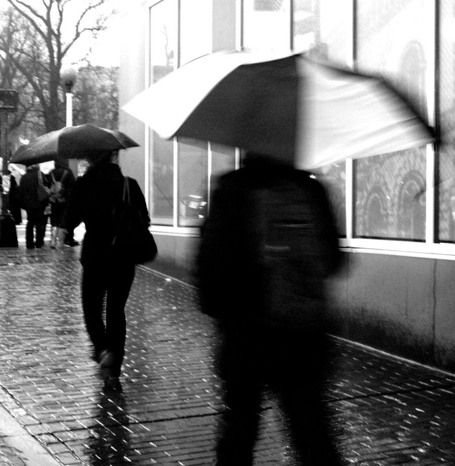 boston downtown crossing umbrellas speeding by
