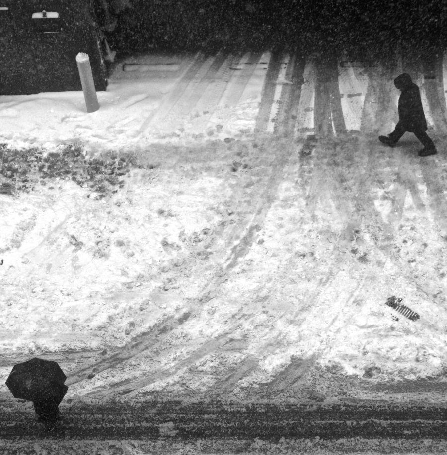 boston chauncey street snow umbrella people walking