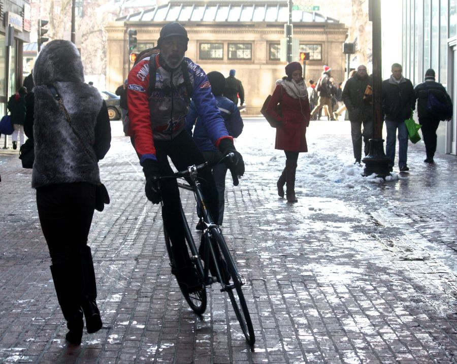 boston downtown crossing man on bicycle