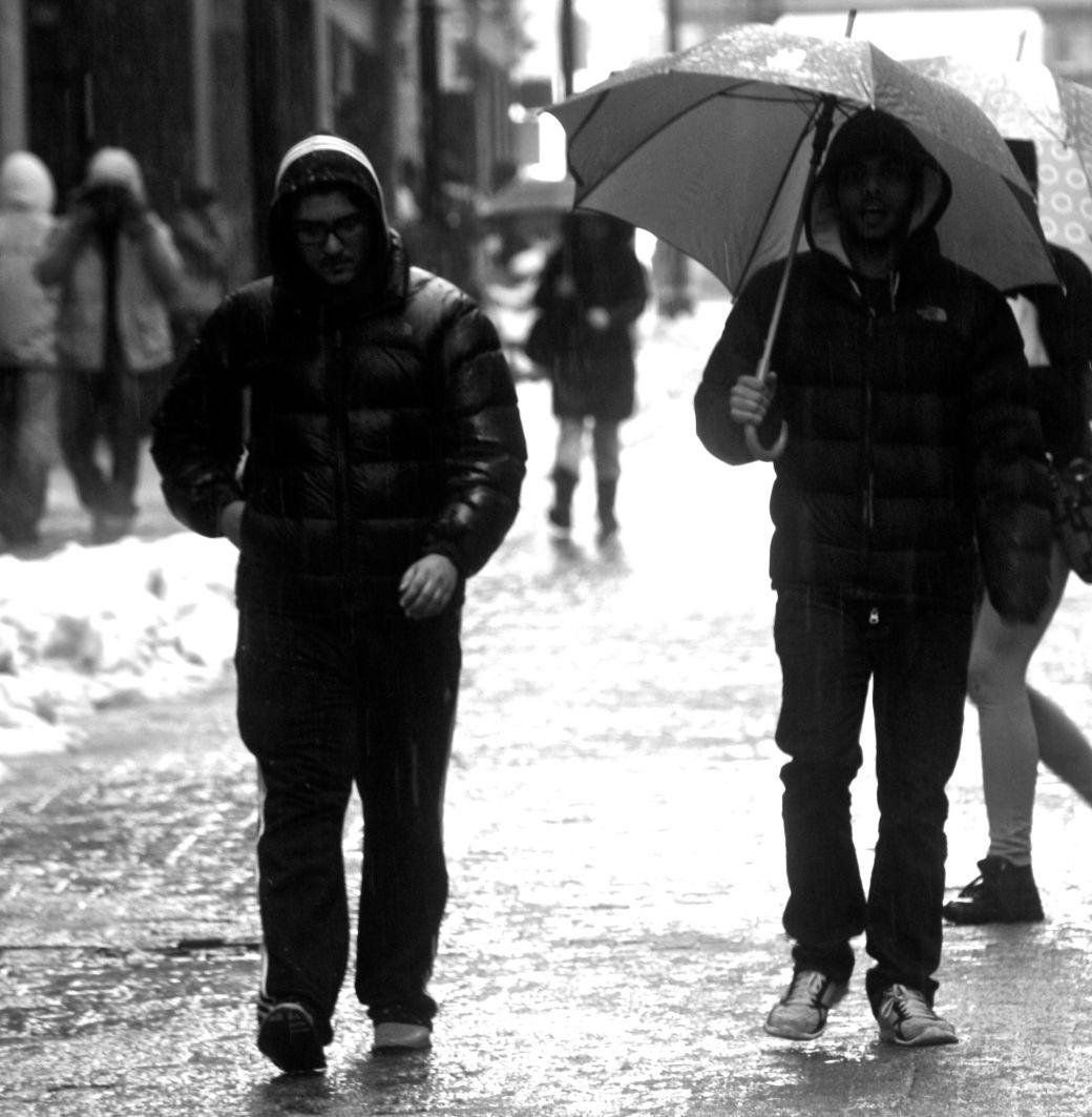 boston downtown crossing people in the rain 3