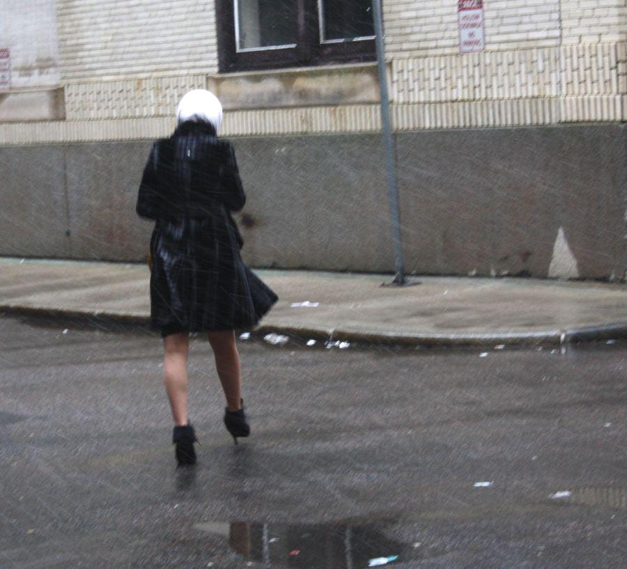 boston snow storm saturn woman walking in storm