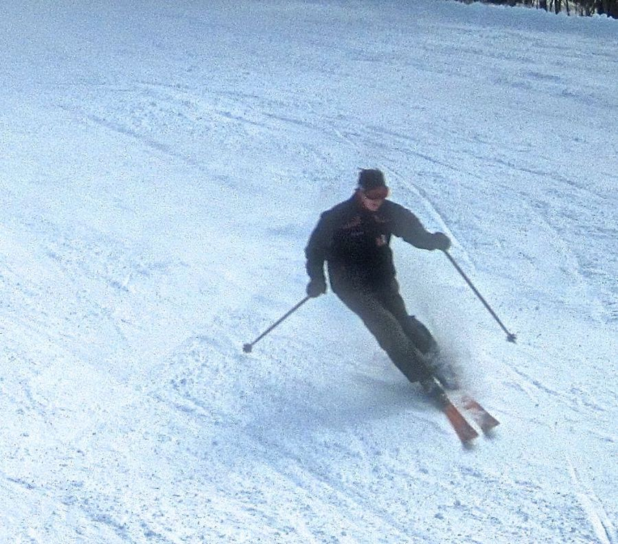 sunapee skier going down mountain