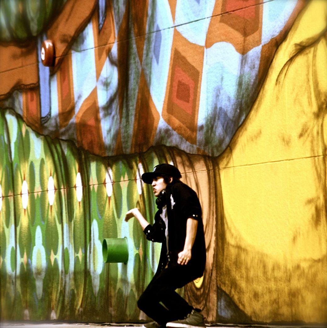 boston greenway os gemeos mural man performing 1