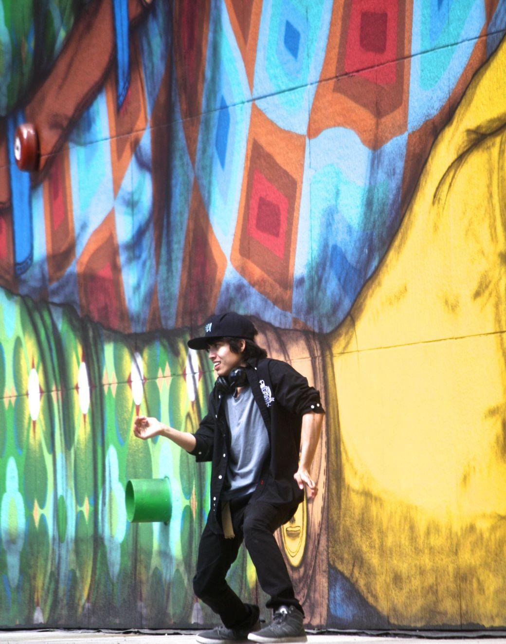 boston greenway os gemeos mural man performing 2