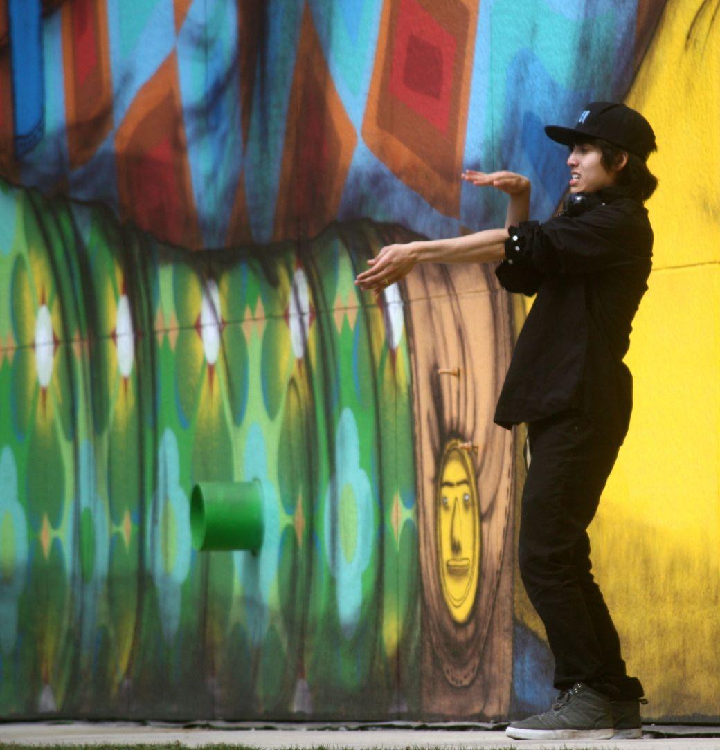 boston greenway os gemeos mural man performing 3