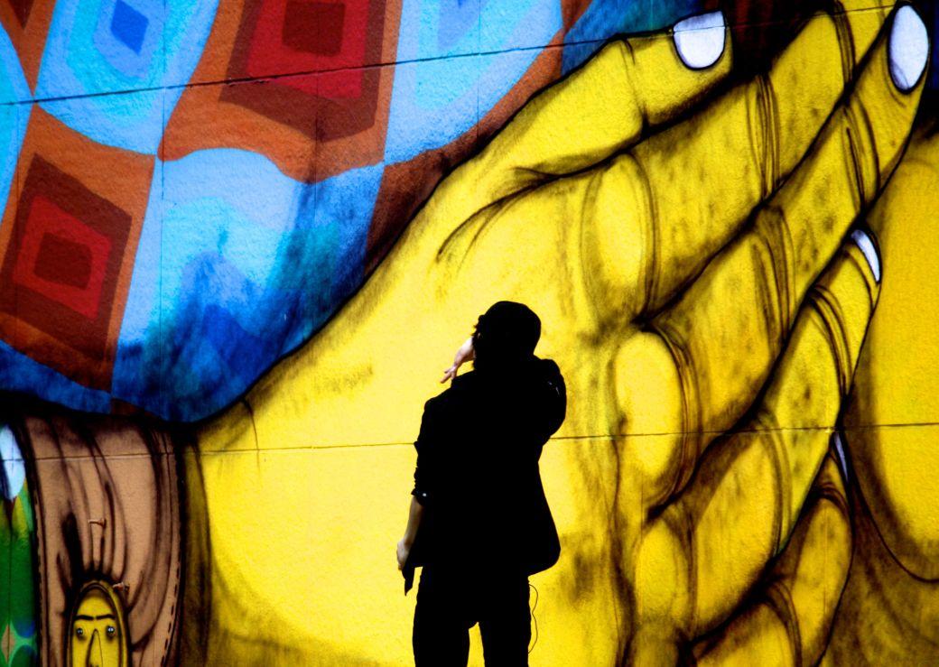 boston greenway os gemeos mural man performing 4