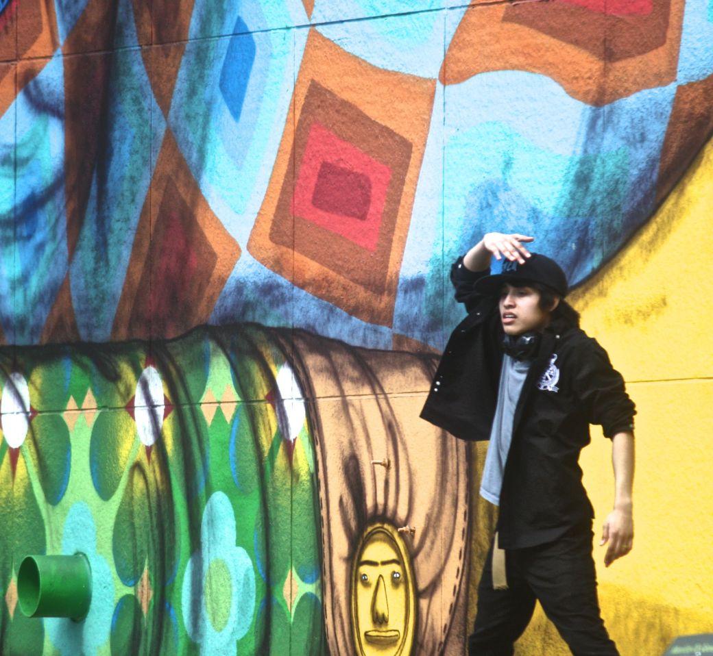 boston greenway os gemeos mural man performing 5