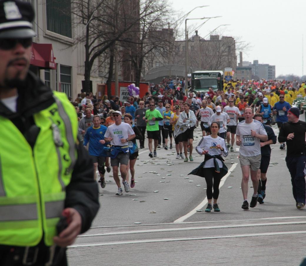 boston marathon 2013 police officer on beacon street runners