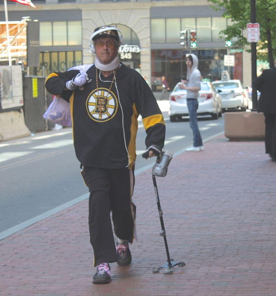 boston downtown crossing man in bruins shirt