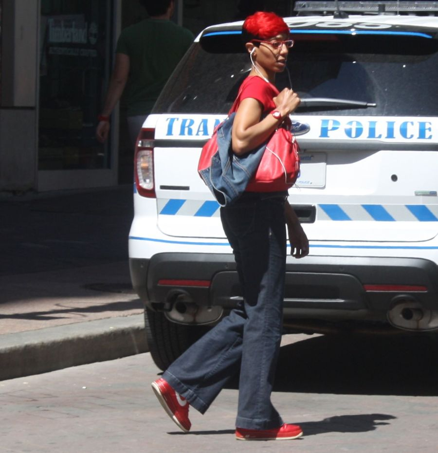 boston downtown crossing woman with red shoes red hair red shirt red bag