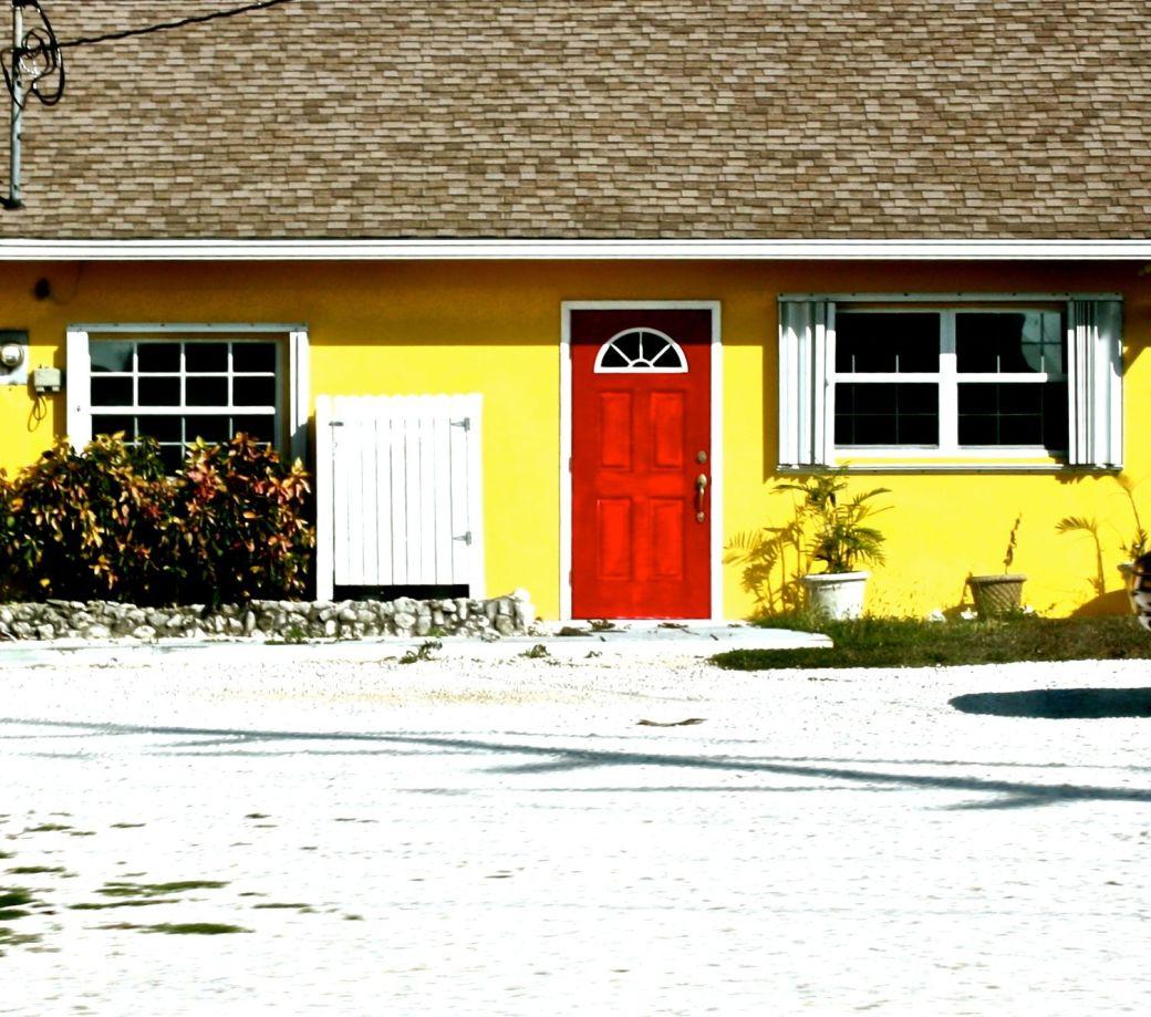 cayman islands house red door yellow walls