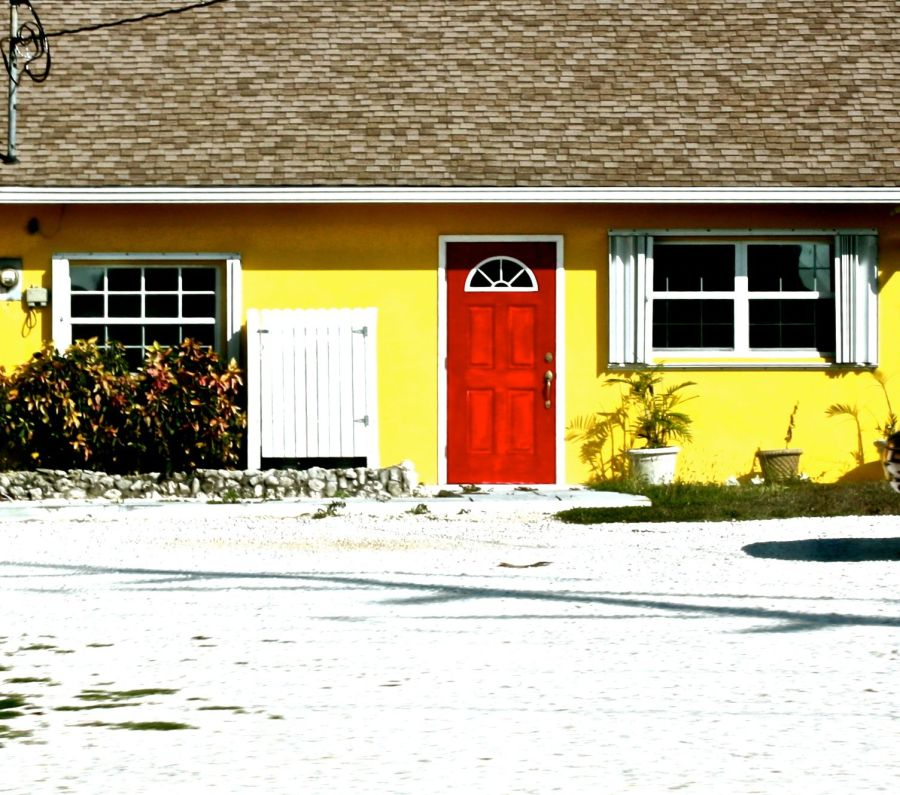 cayman islands house red door yellow walls
