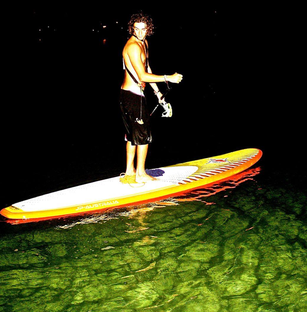 cayman islands kayaker on green water