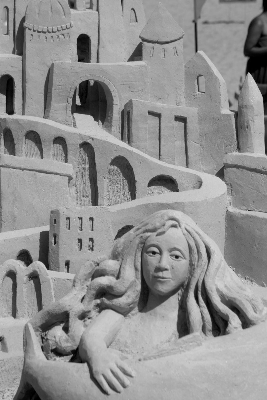 boston revere beach National Sand Sculpting Festival curving castle woman