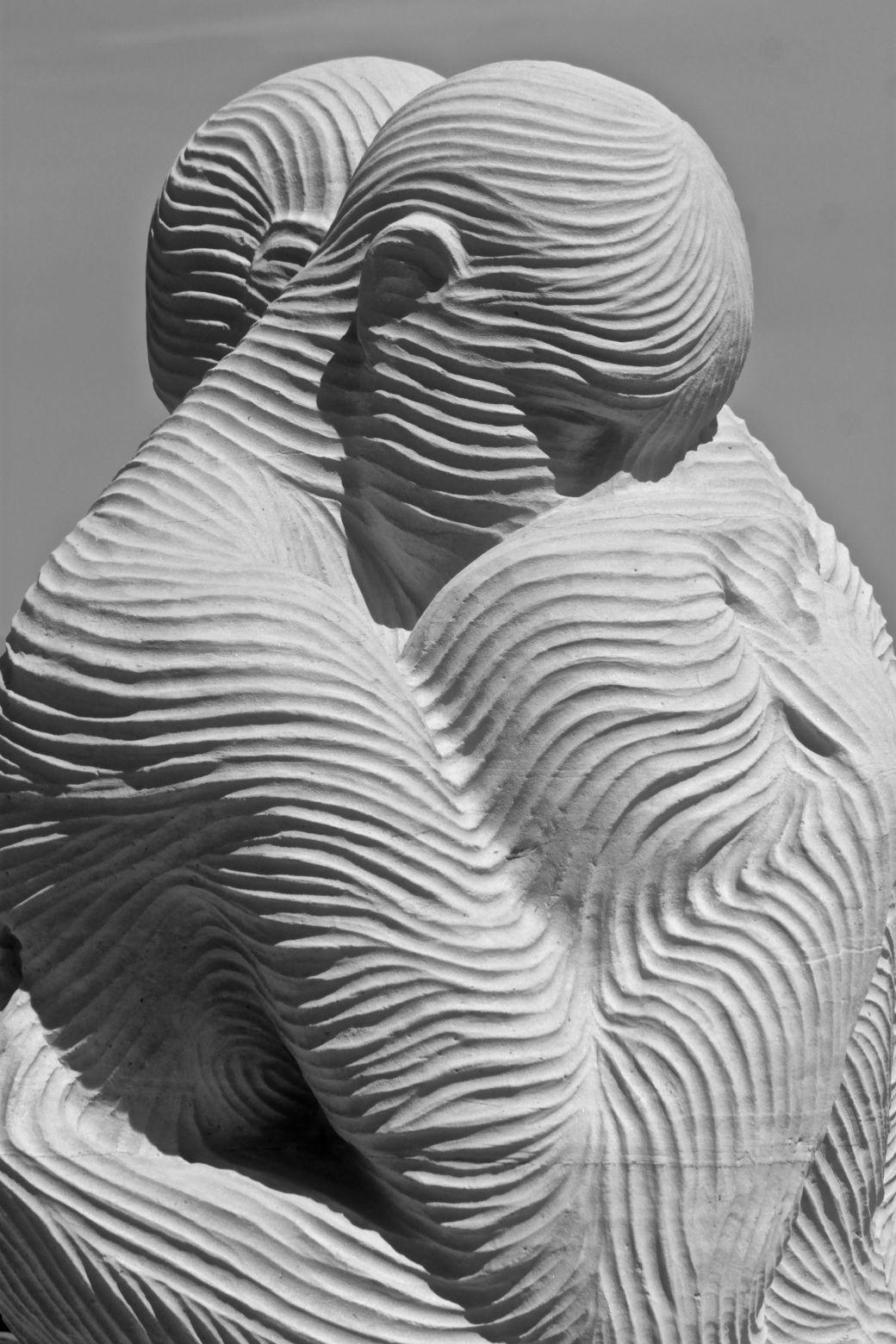 boston revere beach National Sand Sculpting Festival people embracing sand sculpture 2