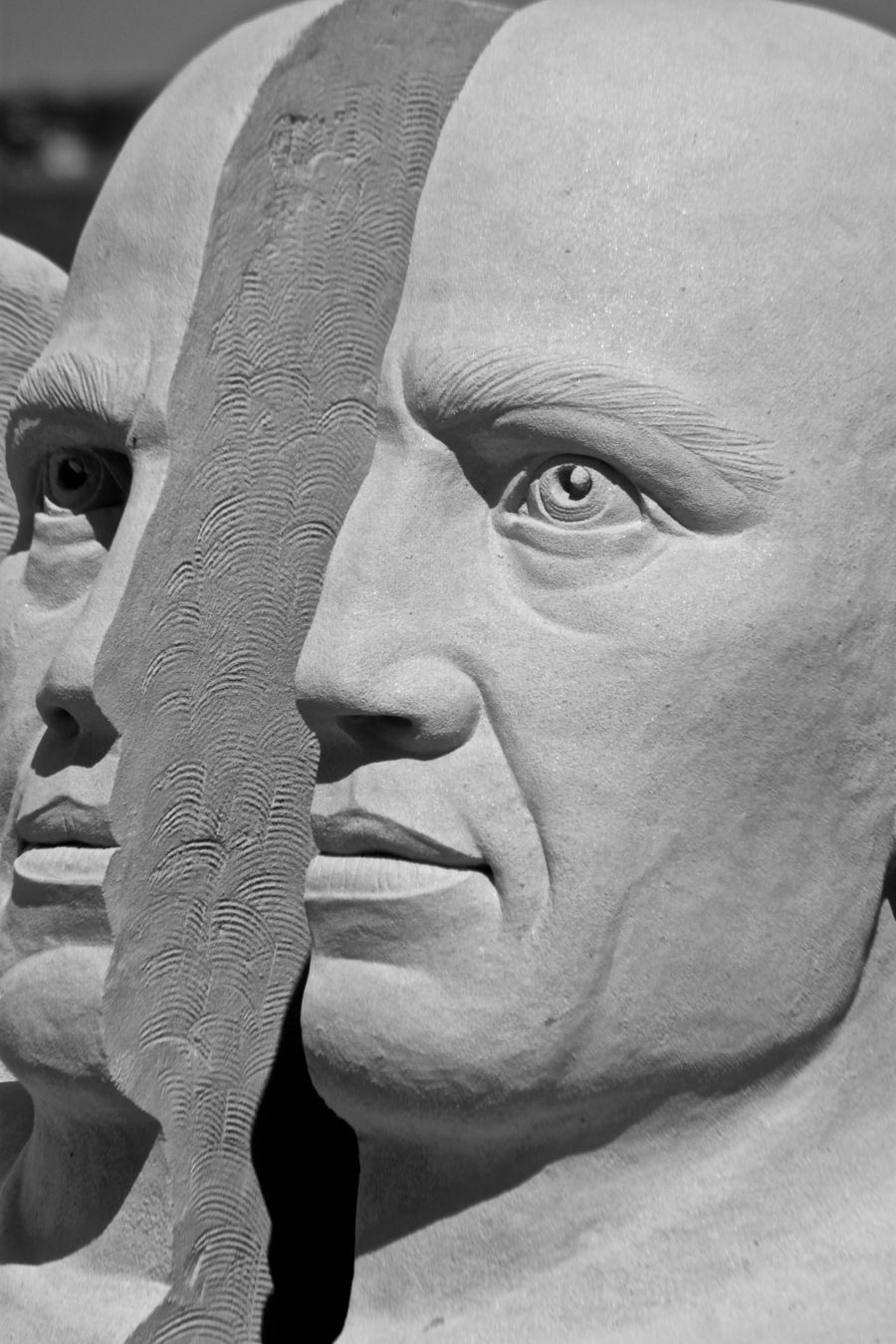 boston revere beach National Sand Sculpting Festival split face sand sculpture black white