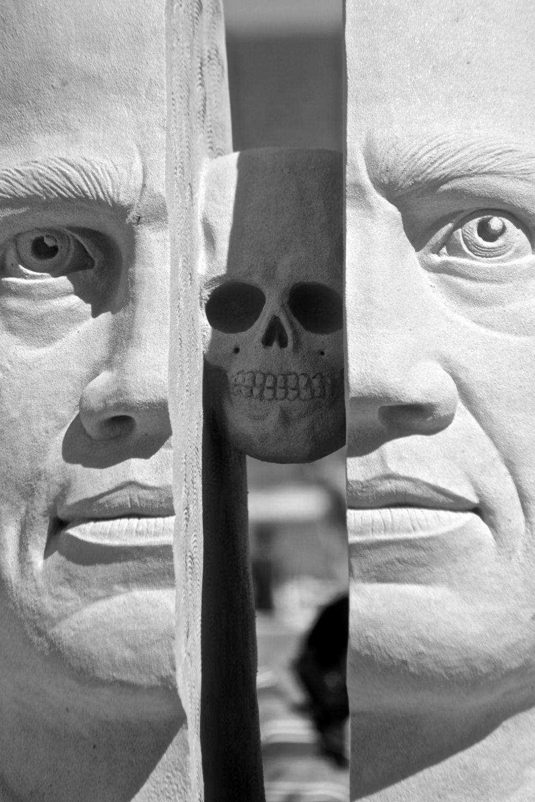 boston revere beach National Sand Sculpting Festival split face sand sculpture skull in the middle