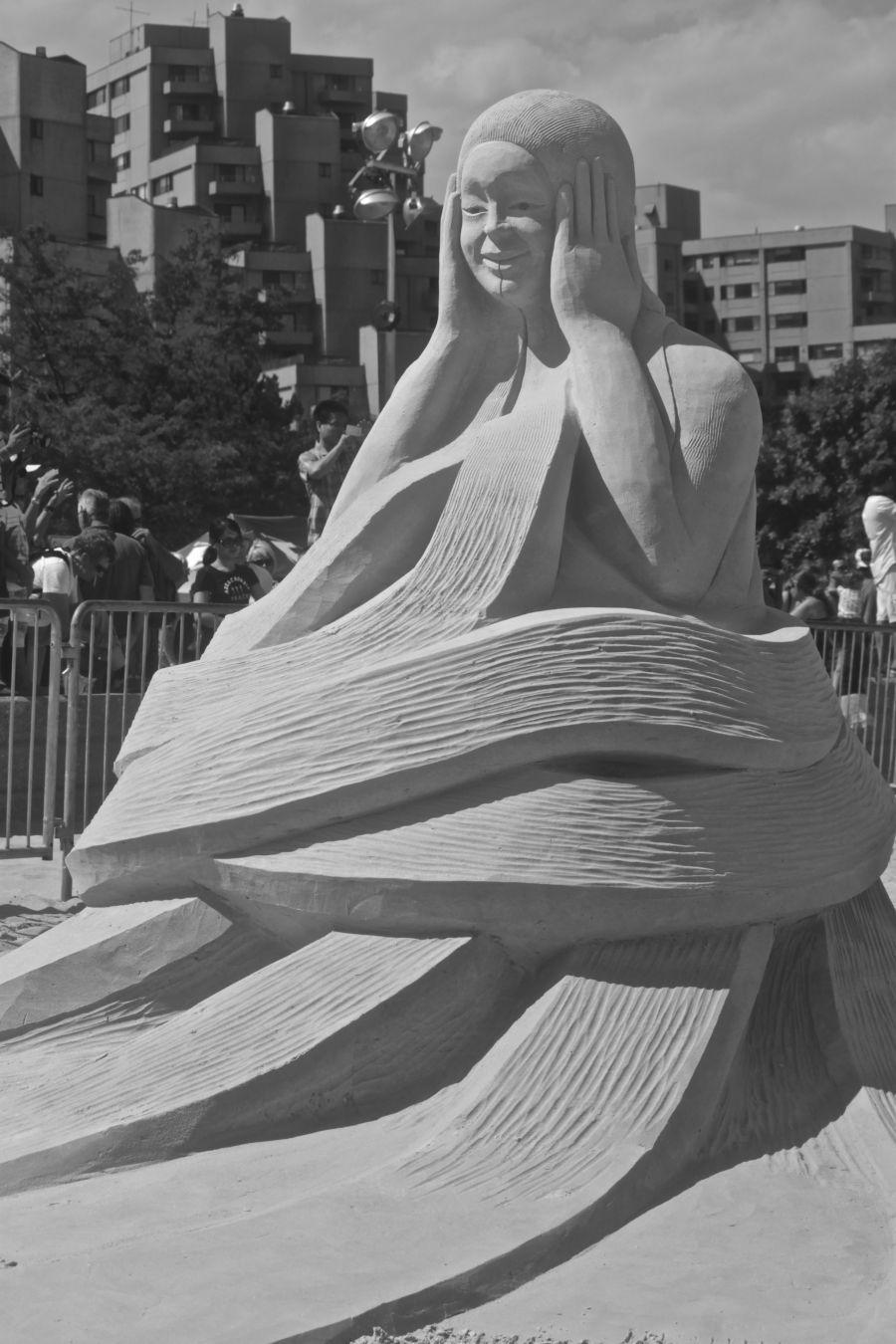 boston revere beach National Sand Sculpting Festival woman curving bottom