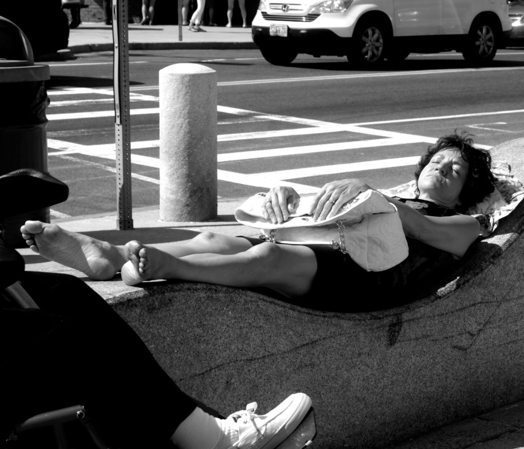 boston revere beach National Sand Sculpting Festival woman sleeping on wave wall