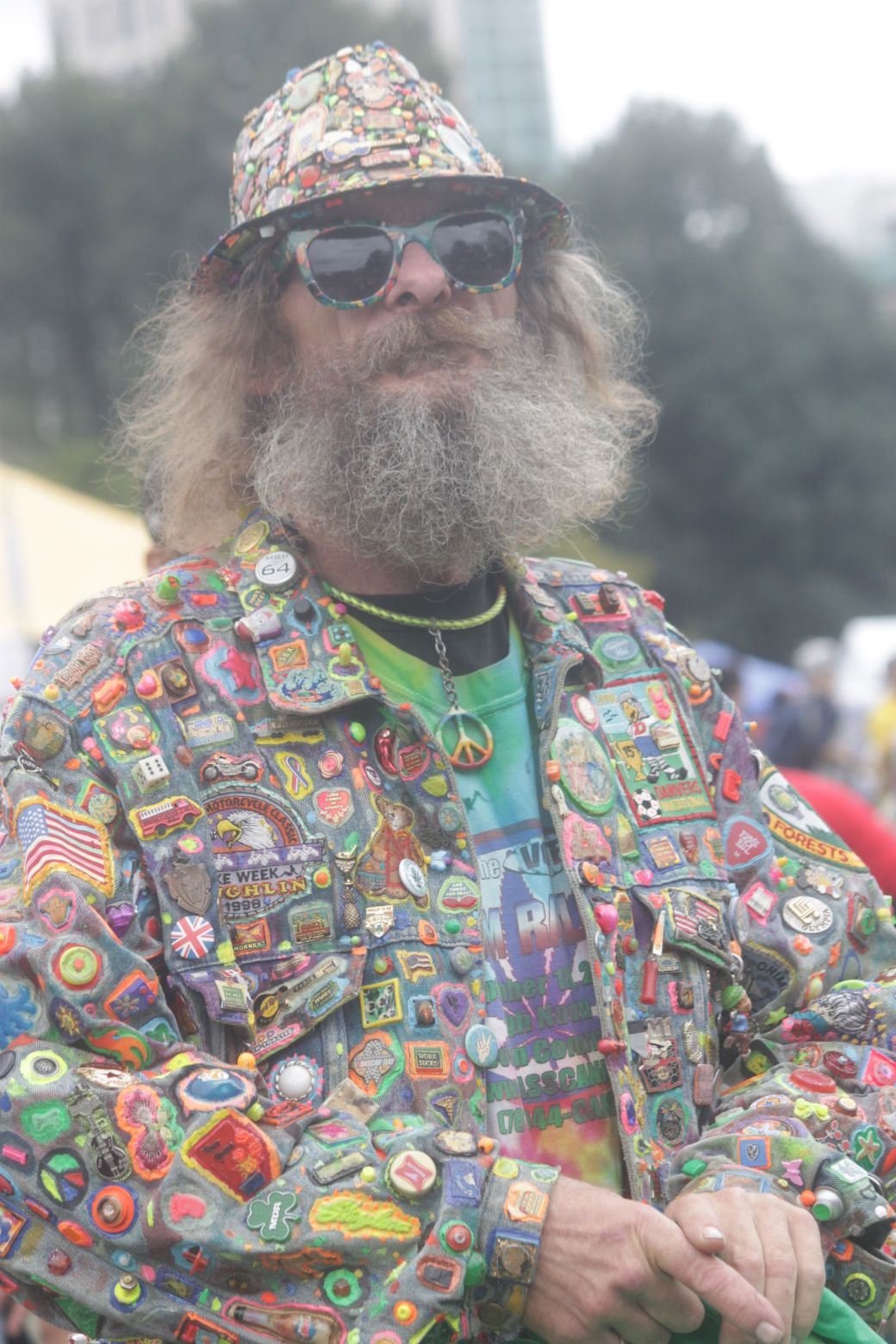 boston hemp fest 2013 man with patches suit hands folded