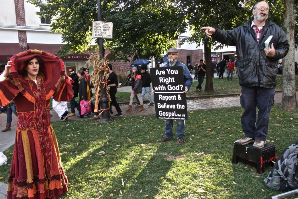 salem halloween 2013 protesters woman in costume