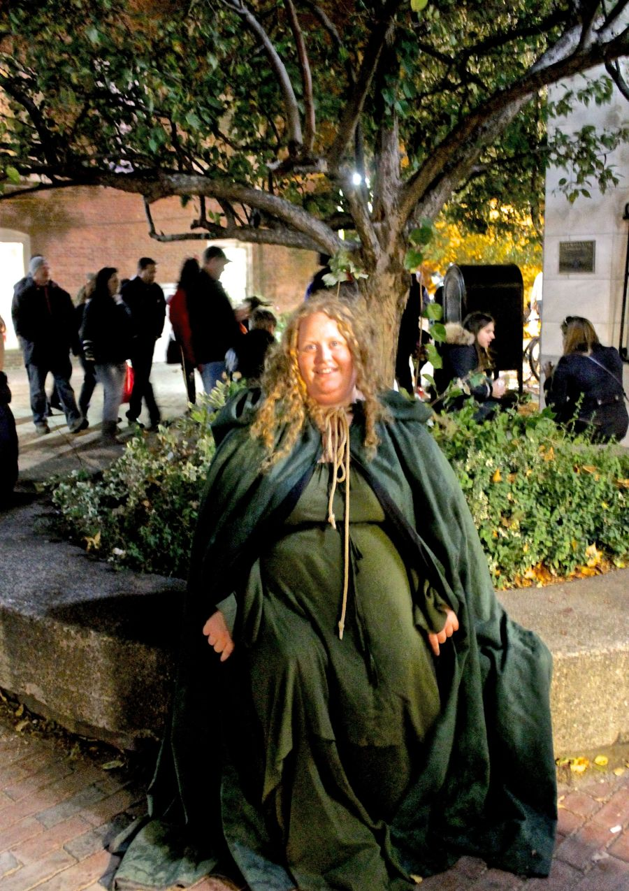 salem halloween 2013 woman in green cloak next to green tree