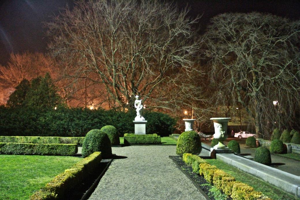 newport the elms garden night statue green orange bushes