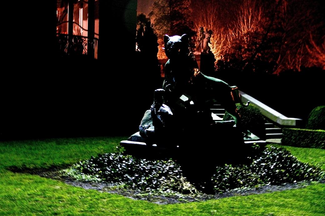 newport the elms garden night statue green orange