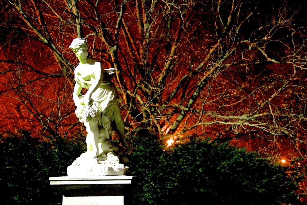 newport the elms garden night statue orange green 2