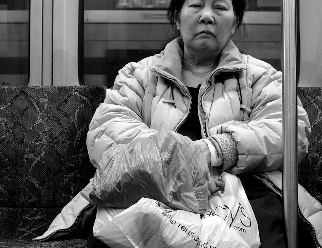 boston red line woman on the train with bags