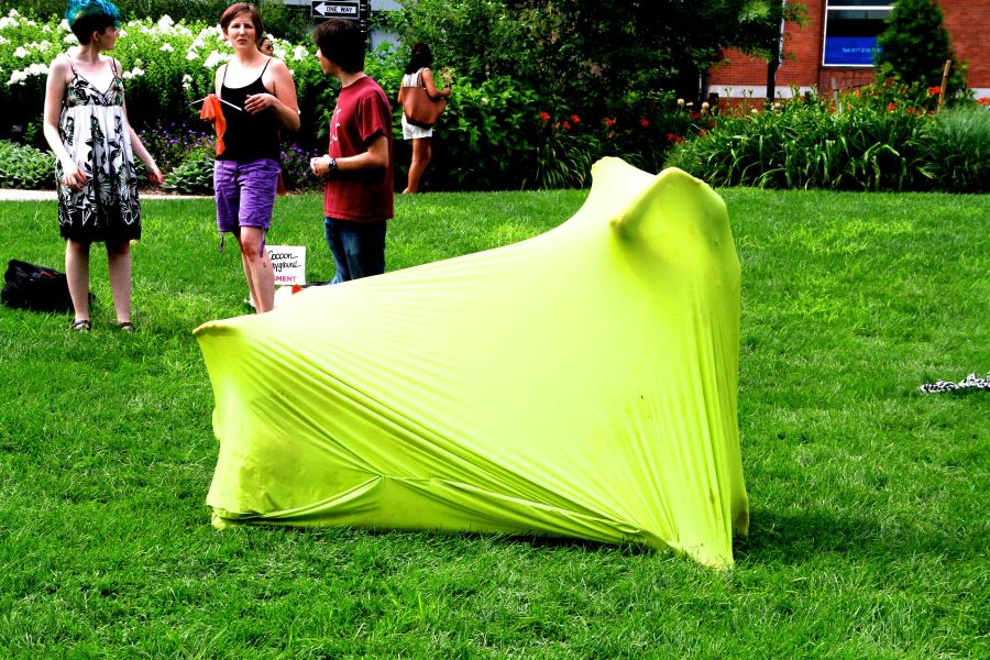 boston greenway person in green stretchy sack 1