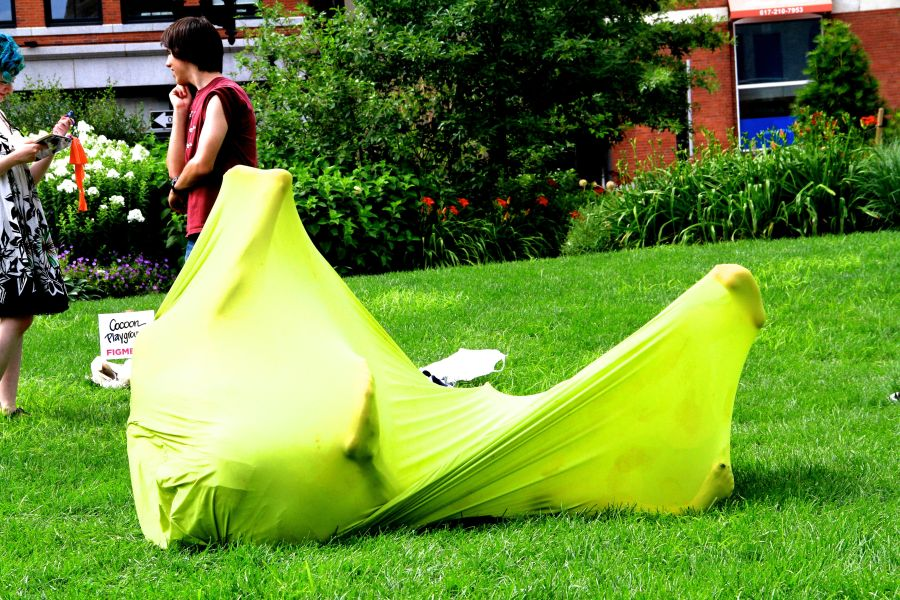 boston greenway person in green stretchy sack 2
