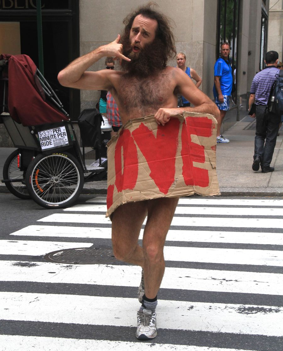 new york city fifth avenue man with love sign