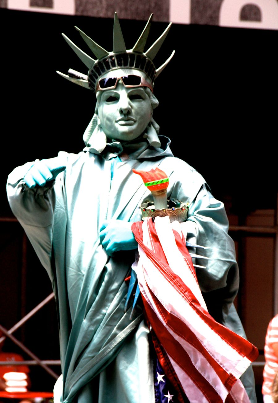 new york city times square man dressed as statue of liberty