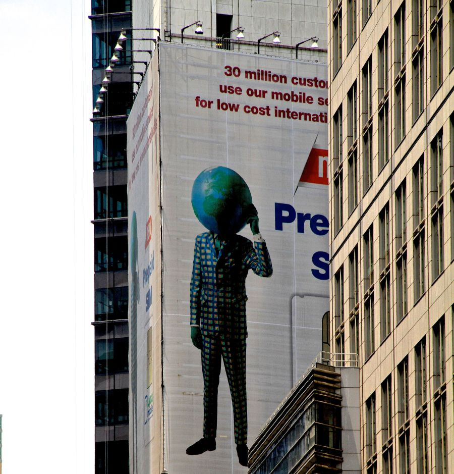 new york city times square suit with earth head advertisment