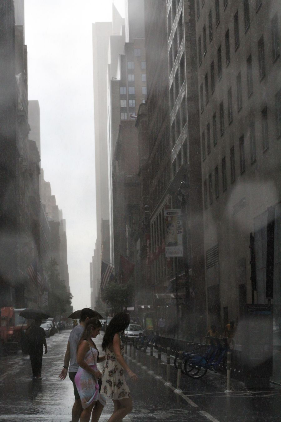 new york city fifth avenue rain drops people