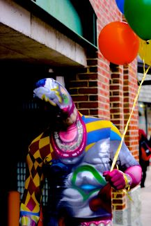 salem halloween october 31 2014 man in colorful costume with balloons