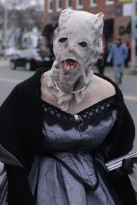 salem halloween october 31 2014 woman with old dress and mask up close