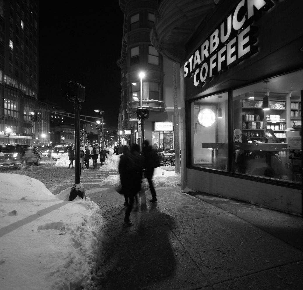 boston massachusetts avenue starbucks coffee snow pile people walking