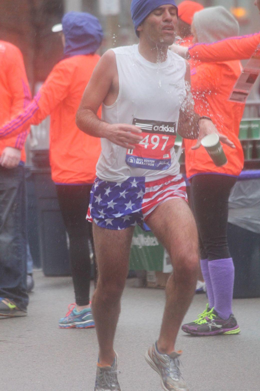 boston marathon april 20 2015 racer number 497 dropping water