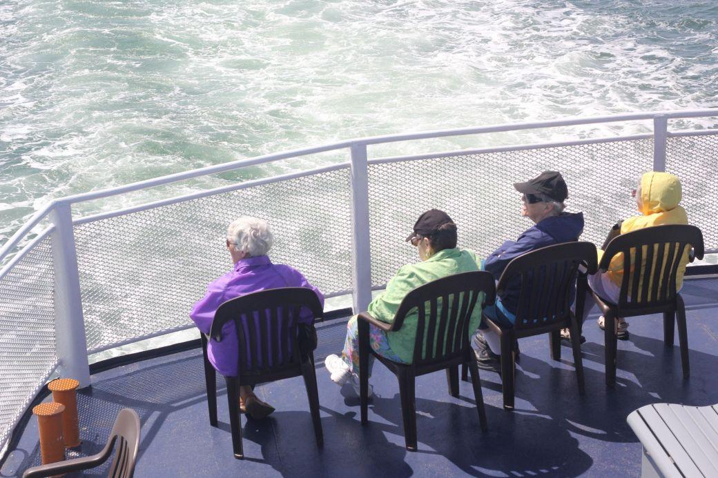 boston harbor islands ferry people sitting