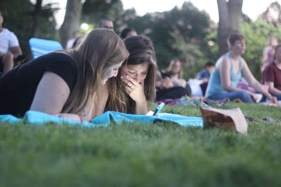 boston hatch shell night movie people girls looking at the phone