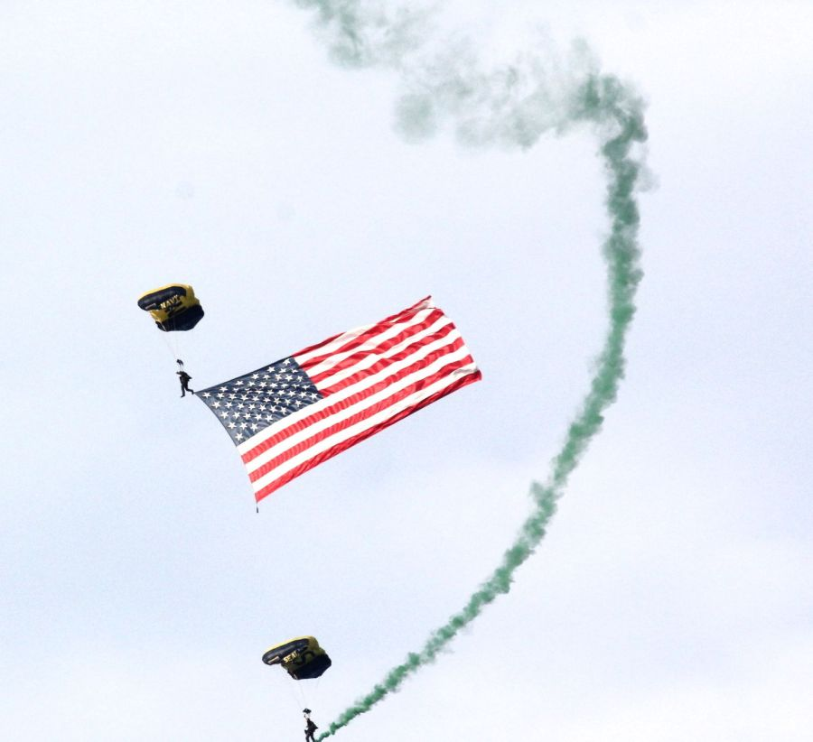 boston july 4th fireworks celebration parachuters with flag and smoke