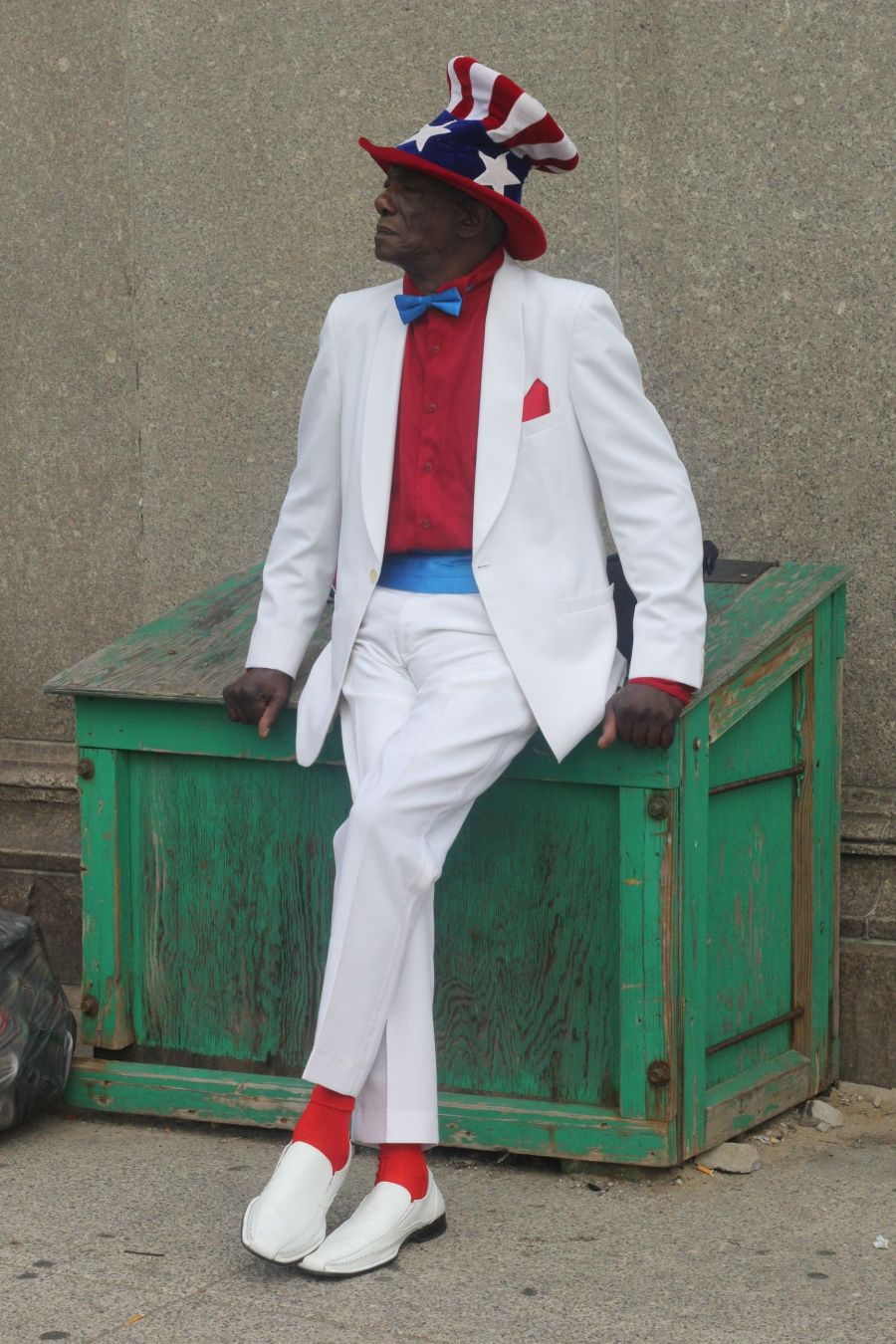 boston park street man in red white and blue suit july 4th