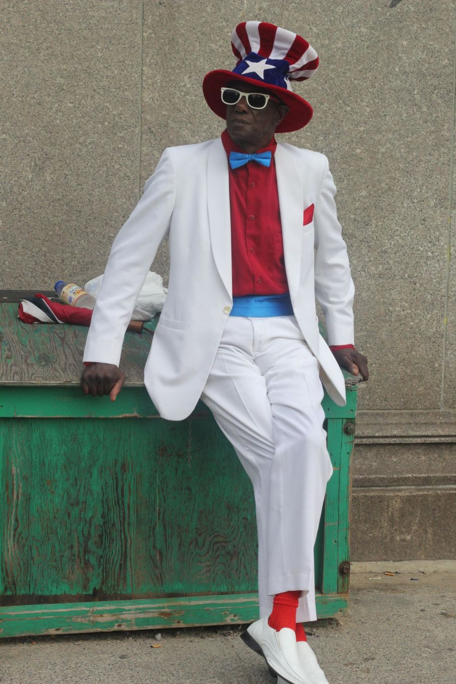 boston park street man in red white blue suit july 4th