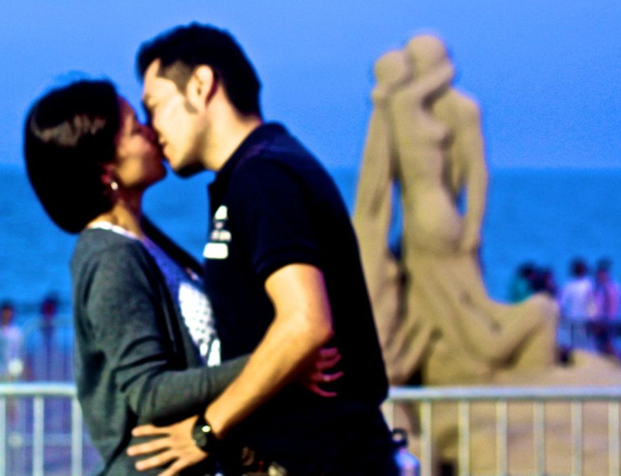 boston sand sculpture festival sand sculpture couple kissing couple kissing in the foreground out of focus