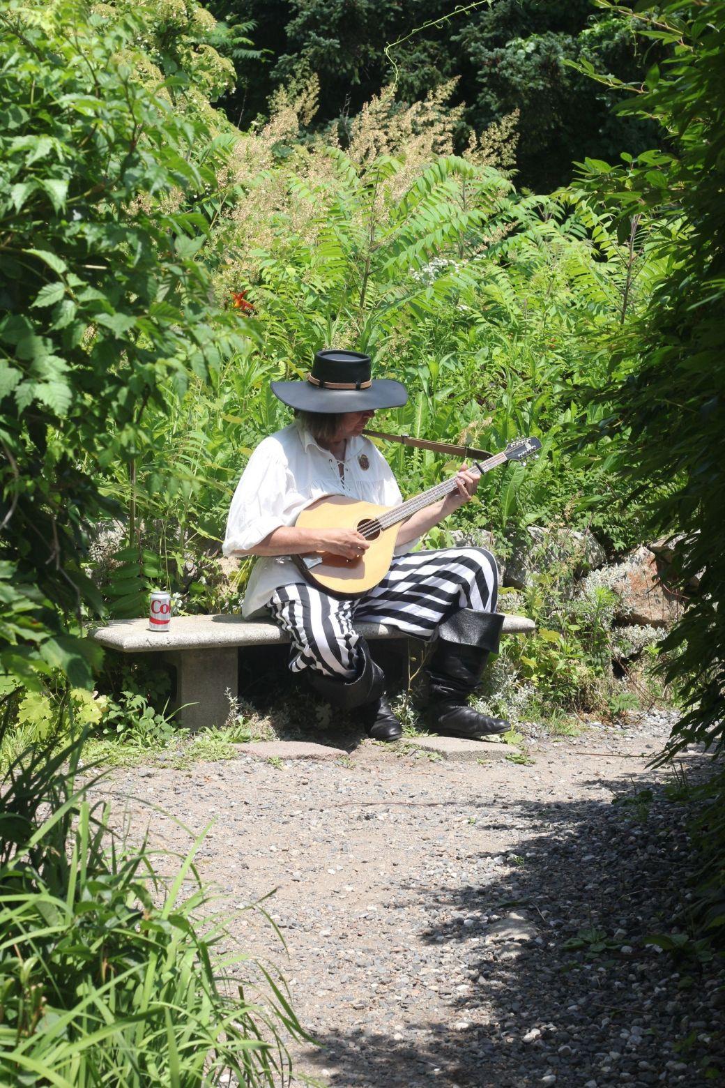 gloucester hammond castle exterior man playing guitar