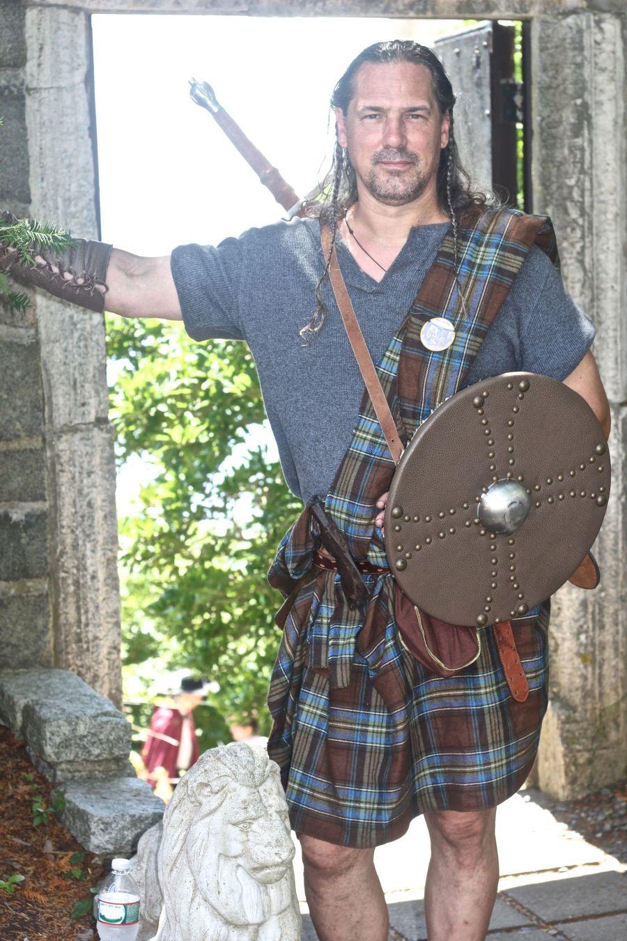 gloucester hammond castle renaissance fair man in quilt with shield